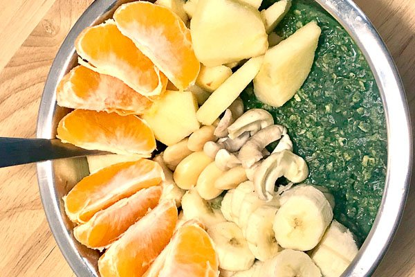 breakfast with oats, fruits, chlorella and nuts
